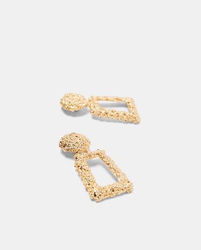 grote gouden oorbellen