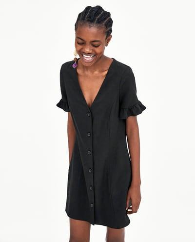zwart kleedje met knopen